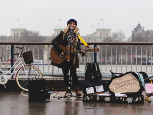 Musician by a river, CC/Public Domain via pxhere.